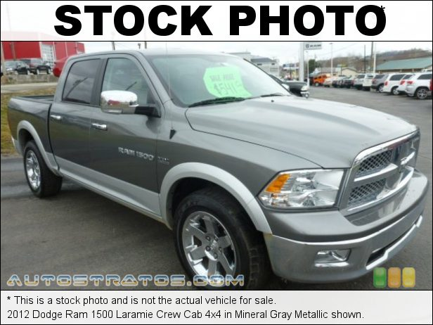 Stock photo for this 2012 Dodge Ram 1500 Laramie Crew Cab 4x4 5.7 Liter HEMI OHV 16-Valve VVT MDS V8 6 Speed Automatic