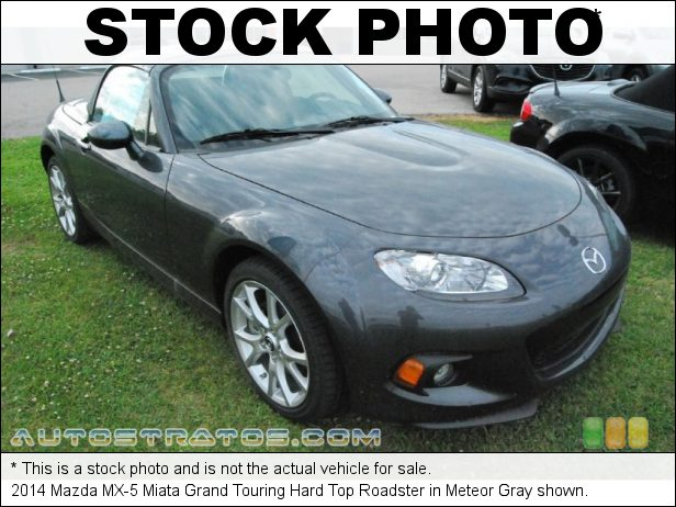 Stock photo for this 2014 Mazda MX-5 Miata Grand Touring Roadster 2.0 Liter MZR DOHC 16-Valve VVT 4 Cylinder 6 Speed Automatic