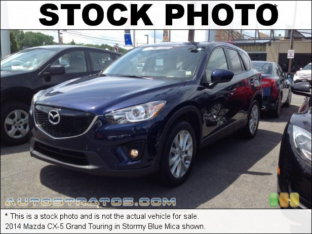 Stock photo for this 2014 Mazda CX-5 Grand Touring 2.5 Liter SKYACTIV-G DOHC 16-valve VVT 4 Cyinder SKYACTIV-Drive 6 Speed Sport Automatic